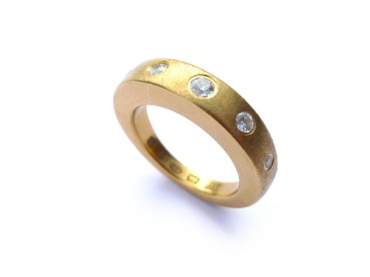 Tawny Phillips - Gold slab ring with white diamonds