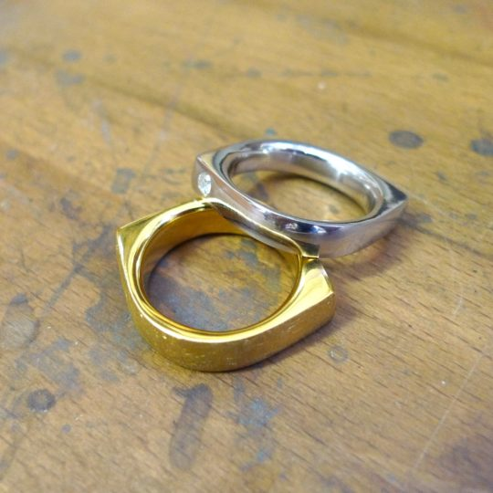 Tawny Phillips - Pair of Gold Eye Wedding Rings