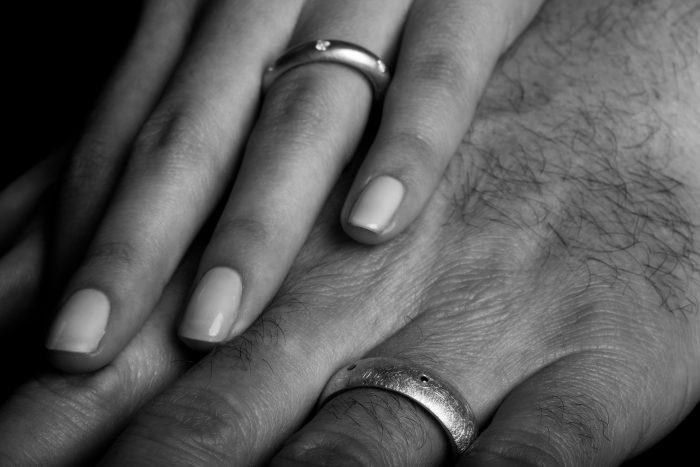Tawny Phillips bespoke diamond set oval gold wedding rings for men and women