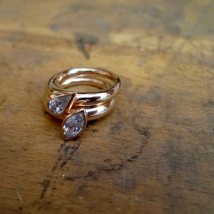 Tawny Phillips teardrop and marquise shaped diamonds set in handmade rose gold wedding rings