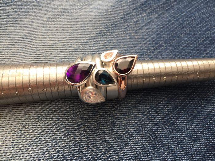 Teardrop shaped rings set in gold